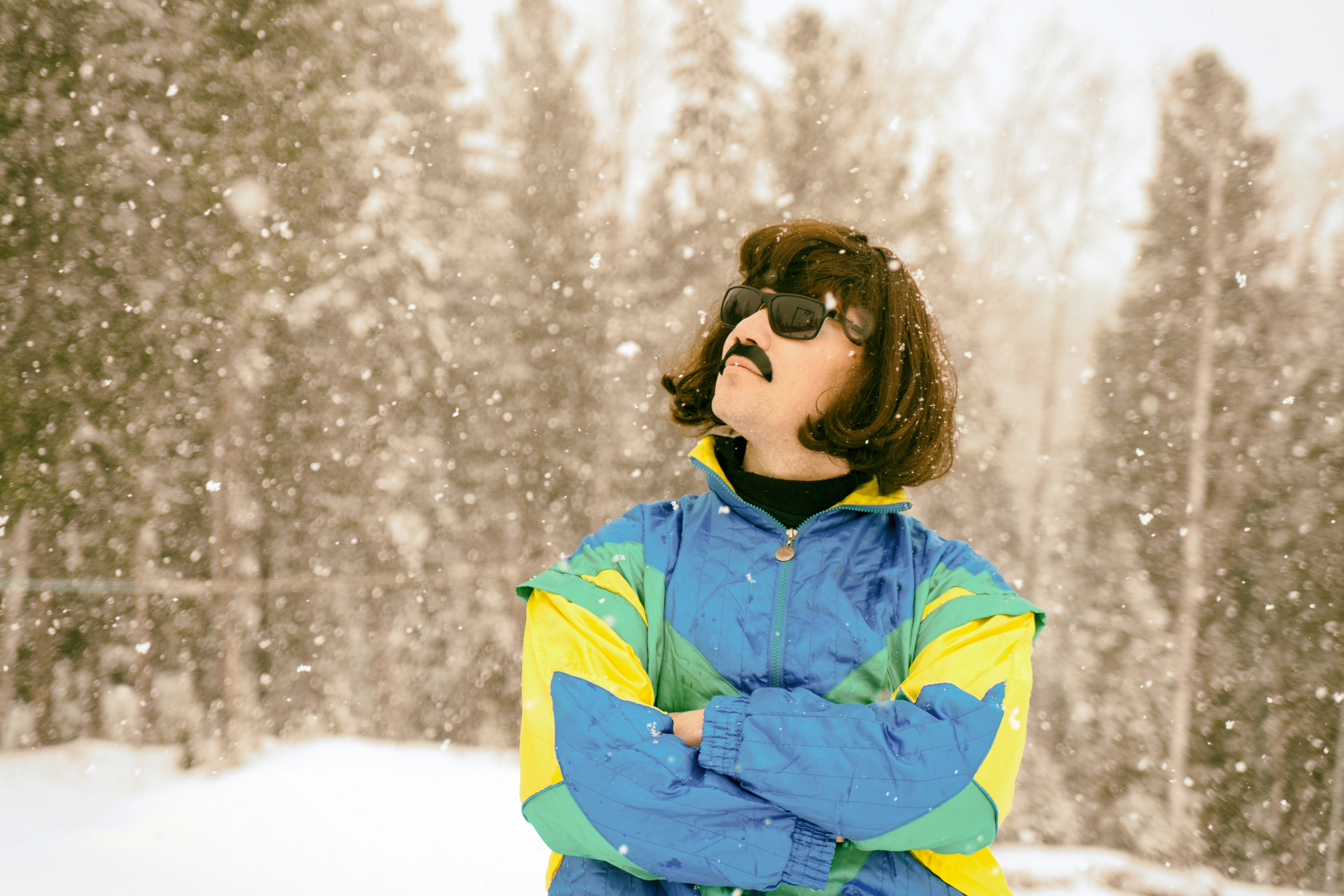 Vintage photo of young man snowboarder in the mountains. Retro style. 1980 concept.
